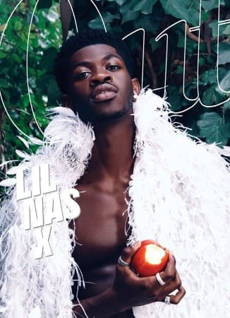 Lil Nas X in a white feathered sweater on the cover of Out
