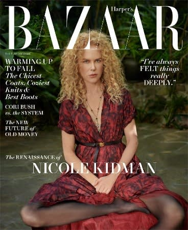 Nicole Kidman sits on the grass in a red dress on the cover of Harper's Bazaar
