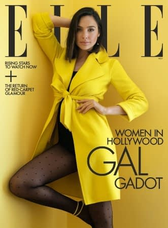 Gal Gadot wears a bright yellow coat on the cover of Elle