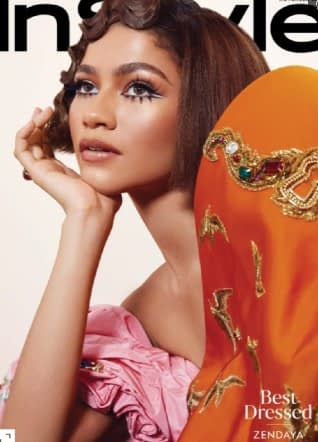 Zendaya wears an orange and pink dress on the cover of InStyle